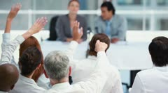 Business people raising their hands to ask questions - stock footage