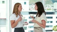 Businesswomen drinking coffee together Stock Footage