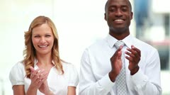 Smiling business people in line applauding Stock Footage