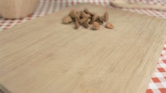 Stock Video Footage of Almonds being spread in super slow motion