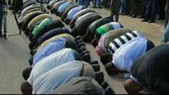 Muslim leaders with Sheikh Kamal Khatib pray during commemoration of Land Day Stock Footage