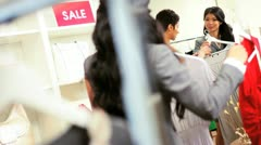 Ethnic Store Assistant with Female Shopper Stock Footage