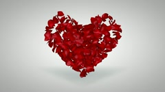 red rose petals fly transition from heart shape to frame - stock footage