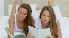 Happy friends listening to music together Stock Footage