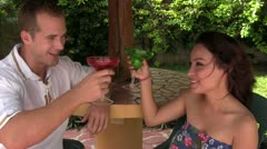 CZA-0094 COUPLE TOASTS WITH TROPICAL DRINKS Stock Footage