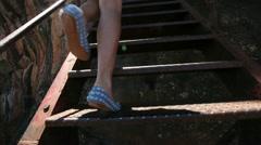 Girl climbs the ladder of iron in Sri Lanka Stock Footage