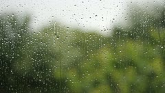 Raindrops running down a window Stock Footage