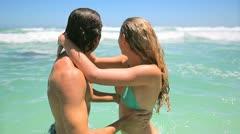 Couple swimming together Stock Footage
