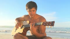 Handsome man playing guitar Stock Footage