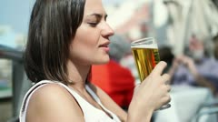 Young attractive woman drinkin beer, outdoors HD Stock Footage