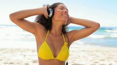 Woman listening music with headphones Stock Footage