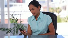 Woman sending a text message Stock Footage
