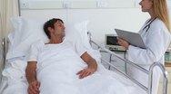Doctor reassuring her patient Stock Footage