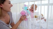 Woman playing dolls with her baby Stock Footage