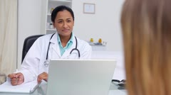 Doctor questioning  a patient - stock footage