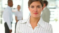 Well dressed woman looking at the camera Stock Footage