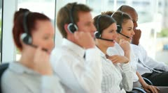 Business workers talking on headsets Stock Footage
