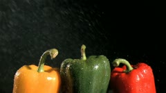 Colorful peppers in super slow motion being wet Stock Footage