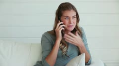 Woman laughing as she talks on a phone Stock Footage
