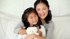 Mother hugging her daughter Stock Footage