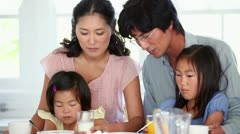 Family having breakfast together - stock footage