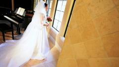 Portrait Caucasian Bride by Baby Grand Piano Stock Footage