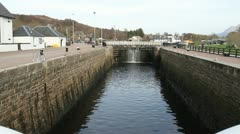 Lock on Caledonian Canal Corpach Scotland Stock Footage