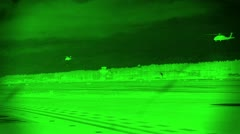 Night Vision View of Black Hawk Helicopters Flying Low at Night Stock Footage