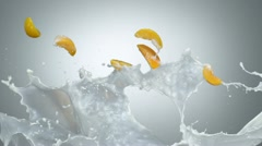 Milk and peach in the air, Slow Motion - stock footage