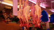Chickens hanging upside down in butcher Stock Footage