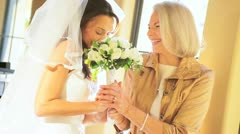Mother and Bride Embracing Before Wedding Ceremony - stock footage