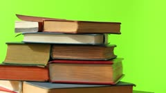 Book stack spin green screen 1 Stock Footage