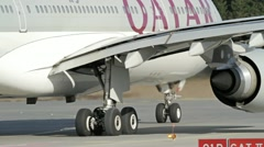Stock Video Footage of Qatar Airways Airbus A-330 taxiing