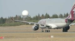 Qatar Airways Airbus A-330 departure Stock Footage