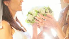 Close up Bride and Mother White Rose Wedding Bouquet Stock Footage