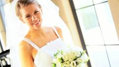 Beautiful young blonde female bridal wear turning smiling camera - stock footage