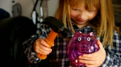 Beaking a piggy bank Stock Footage