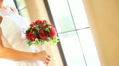 Bride in traditional white wedding dress with flower posy luxury home Stock Footage