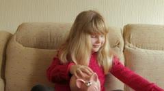 Girl retrieving savings Stock Footage