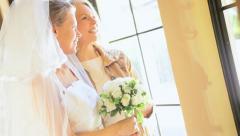 Proud Grandmother Posing Granddaughter in Wedding Dress - stock footage