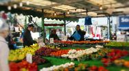 Market stall with asian man serving customers Stock Footage