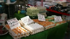 Eggs at market stall Stock Footage