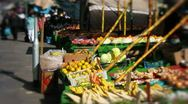 Wide shot of people shopping at a market Stock Footage