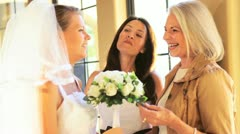 Mother Grandmother Admiring Bridal Bouquet - stock footage