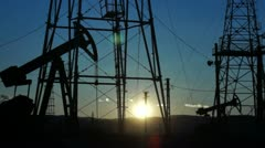 Oil Derrick mechanism in the sunset Stock Footage