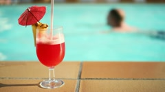 Summer drink with umbrella by the swimming pool HD Stock Footage