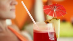 Woman holding and drinking exotic cocktail, close up HD Stock Footage