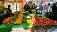Market stall holder fruit and vegetables display Stock Footage