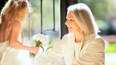 Proud Grandma Admiring Granddaughter Bridesmaid Dress Stock Footage