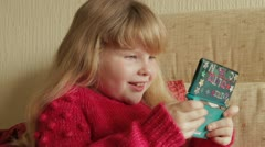 Girl playing nintendo Stock Footage
